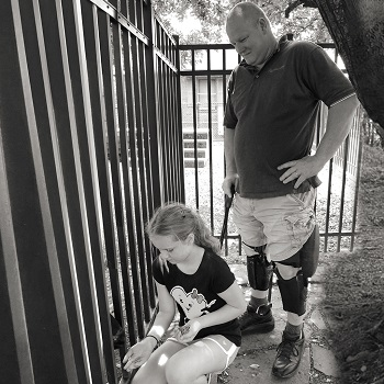 father standing with c-brace with daughter at zoo